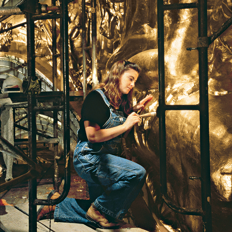 Decorative painter Jacqueline Canning Riccio of John Canning & Co. gilds a horse for the War Memorial Opera House in San Francisco, California. Photo courtesy John Canning & Co.