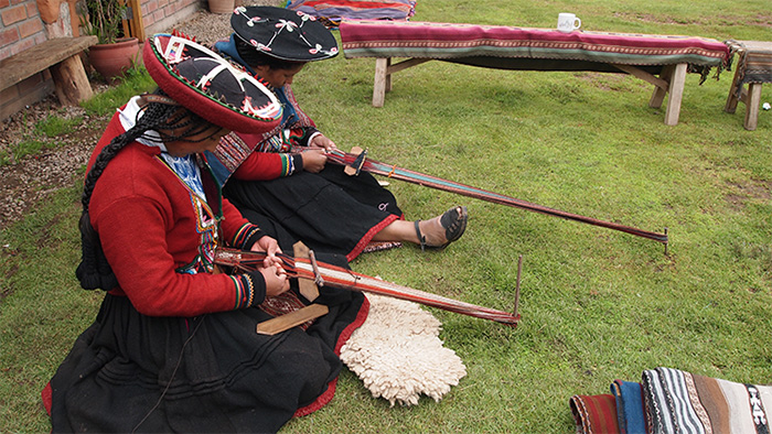 At the Center of Traditional Textiles in Cusco (el Centro de Textiles Tradicionales del Cusco), women from Chinchero demonstrate the art of weaving with a backstrap loom.  Photo by Cristina Diaz-Carrera, Ralph Rinzler Folklife Archives and Collections, Smithsonian Institution