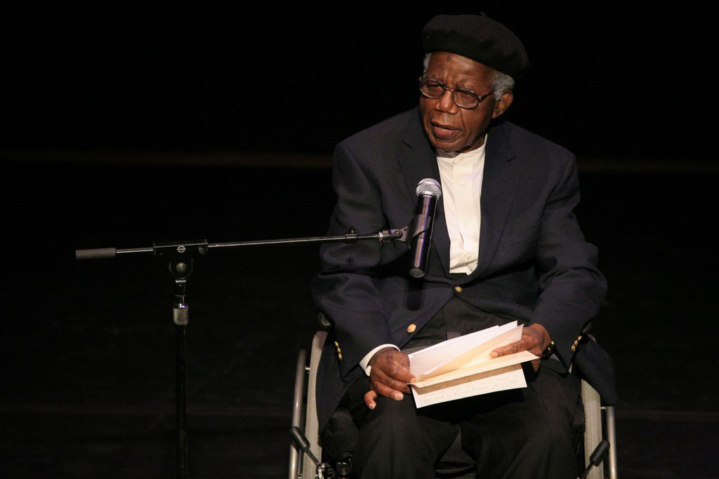 Chinua Achebe speaking at the fiftieth anniversary of <i>Things Fall Apart</i>. Photo by Angela Radulescu