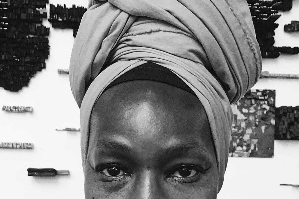Woman with headwrap. B/W. Photo by Richard Collins, Smithsonian Learning Lab
