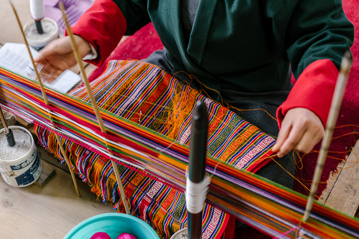A student weaves at the Choki Traditional Art School, established in 1999 on the outskirts of Thimphu, Bhutan, for underprivileged children to learn painting, wood carving, weaving and embroidery. Photo by Jake Naughton