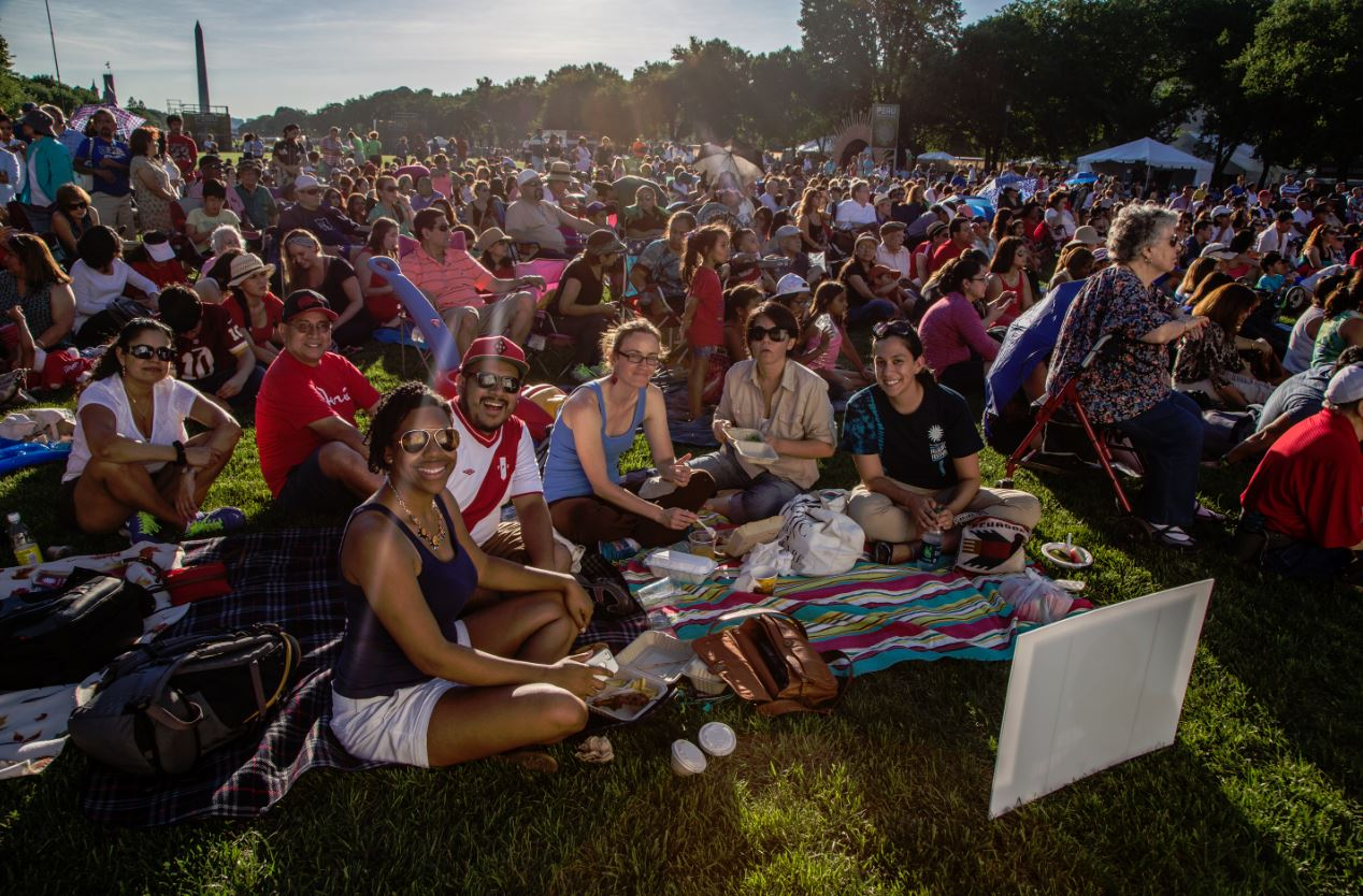 Visitors at the 2015 Smithsonian Folklife Festival relax on the National Mall in preparation for an evening concert. Photo by Francisco Guerra, Ralph Rinzler Folklife Archives