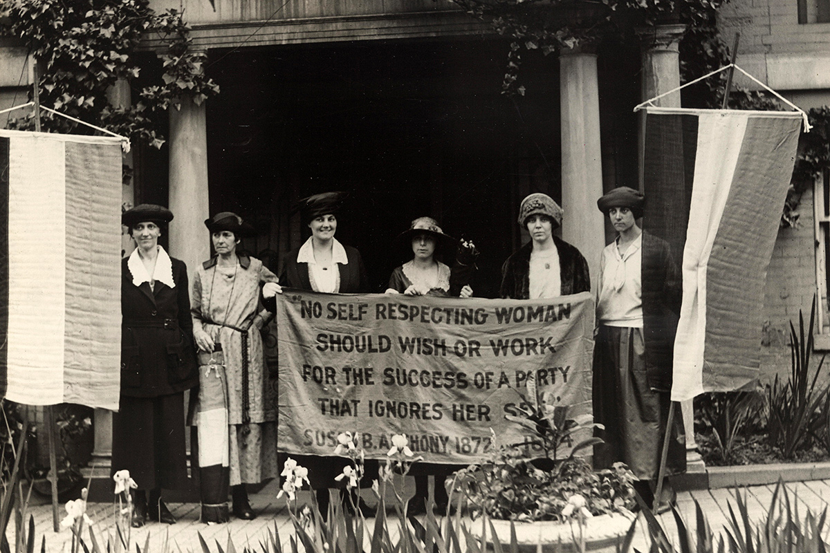 "At the 1920 Republican National Convention in Chicago, Mrs. James Rector, Mary Dubrow, and Alice Paul (left to right) hold a banner that reads, ""No self respecting woman should wish or work for the success of a party that ignores her sex. Susan B. Anthony, 1872."" 