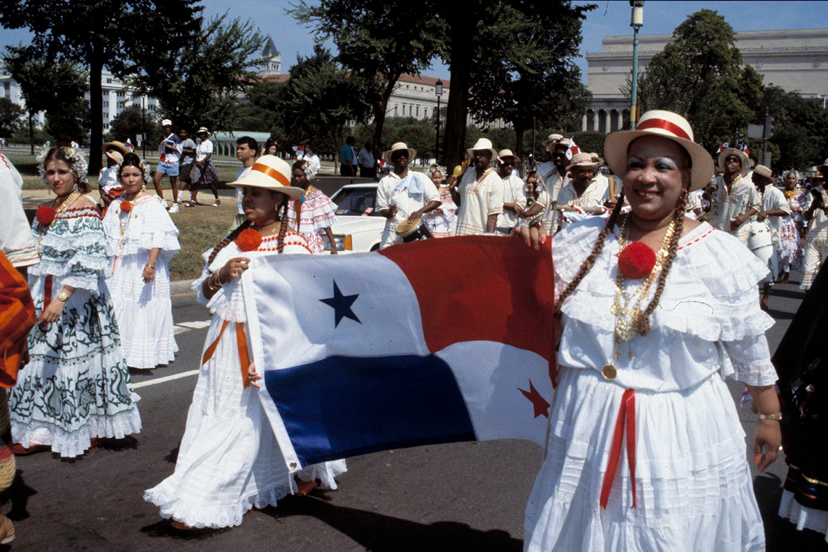 Women carry the Panamanian flag at the 1993 Latin American Festival in Washington, D.C. Photo by Harold Dorwin, Black Mosaic Exhibition Records, Anacostia Community Museum Archives, Smithsonian Institution