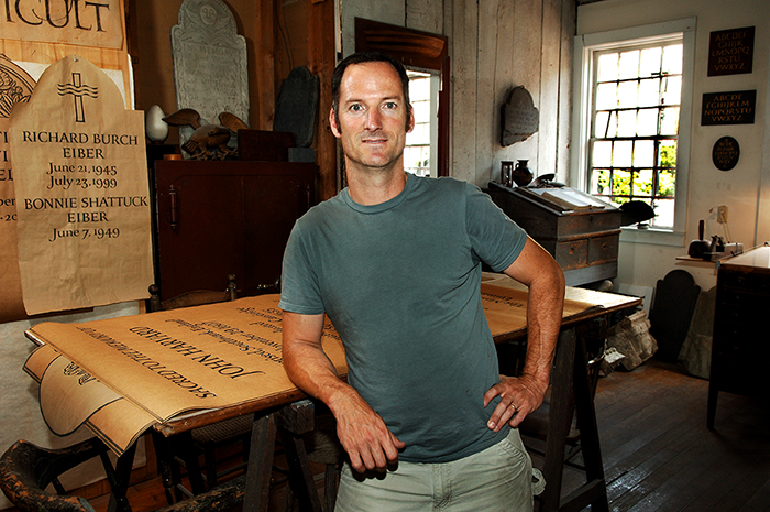 Nick Benson, a third-generation stone carver and letterer, is the owner and creative director of The John Stevens Shop in Newport, Rhode Island. Photo by Tom Pich