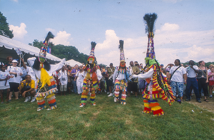 "A <i> gombey </i> ""clash"" dance at the 2001 Smithsonian Folklife Festival. Ralph Rinzler Folklife Archives and Collections, Smithsonian Institution"