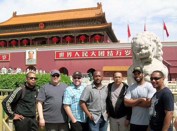 Members of Los Texmaniacs and Tremé Brass Band strike a pose in front of Mao Zedong's portrait and a stone lion in Beijing's Forbidden City. Photo by James Deutsch