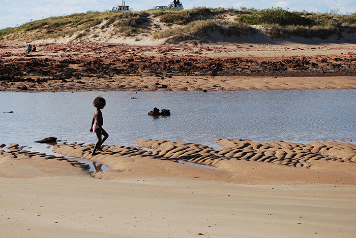 Martu girl beachcombing in Western Australia. Photo by Brooke Scelza, courtesy of World on the Move