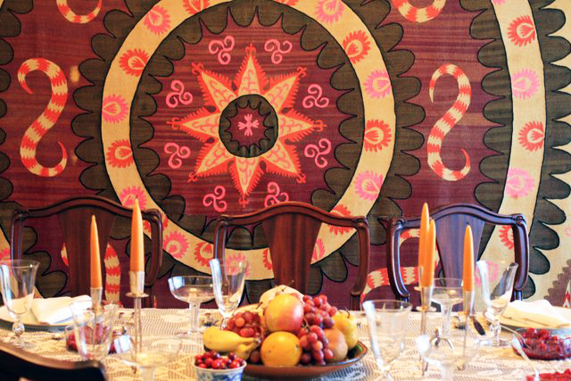 Renny Smith's holiday table setting, with Tajik tapestry in the background. Photo by Renny Smith