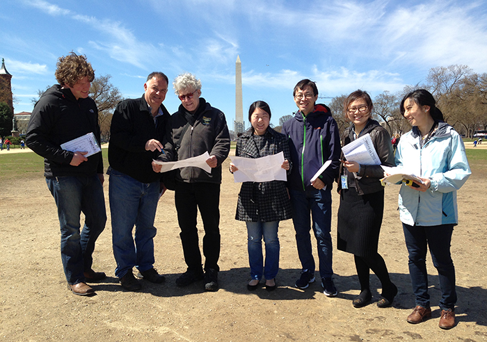 Jing Li (second from right) and members of the China program and Festival production teams plot out the site on the National Mall. Photo by Sojin Kim, Ralph Rinzler Folklife Archives