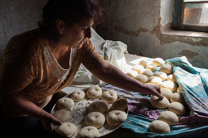 Rima Timbaryan collects dough for baking. Photo by Sossi Madzounian, Smithsonian