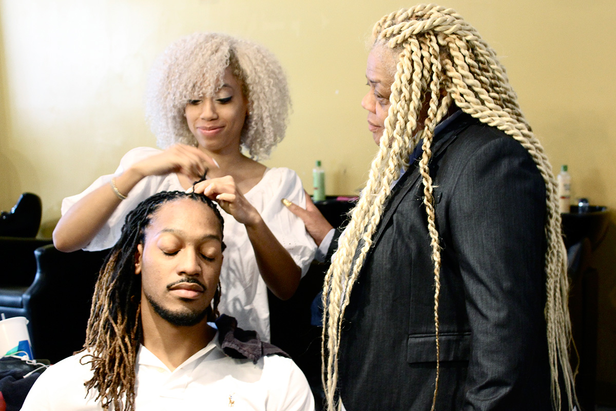Stylist Markita Johnson works with a client at Wanda's at 7th while Wanda Henderson oversees. Photo by Angela Calonder