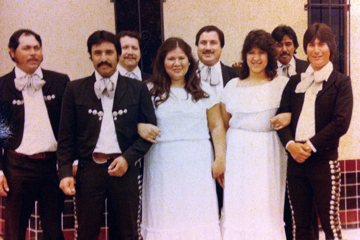 The first ensemble Carmen Dias joined was Mariachi Los Caballeros, pictured here in 1983. She and her sister Veronica (Bernal) Ramos (left) were the first women to play in a mariachi in the Central Valley. Photo courtesy of Carmen Dias