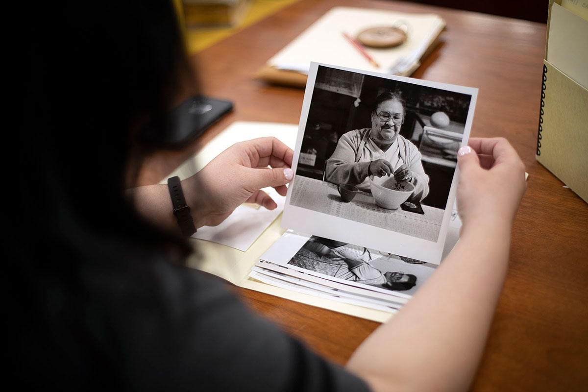 Ashley Minner holds an image of her husband's grandmother, Alme Jones, from the Baltimore News American collection at University of Maryland, College Park. Photo by Xueying Chang