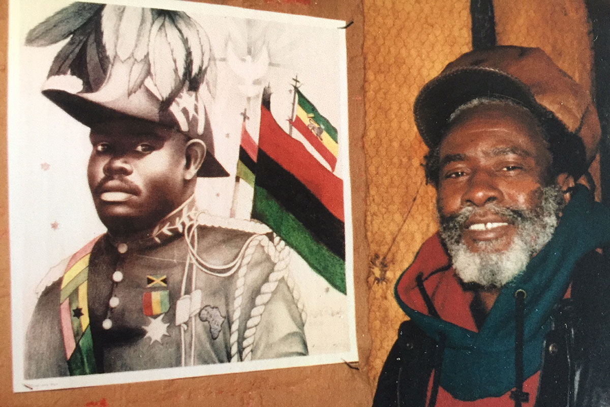 Burning Spear (aka Winston Rodney) with a poster of Jamaican-born Black nationalist and leader of the Pan-Africanism movement Marcus Garvey, ca. 1998. <br><br><i>Photo by Asher Hammang</i>