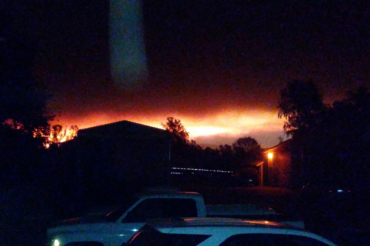 The Tubbs Fire burning the night of October 8, 2017, as seen from my aunt's house in West Santa Rosa, looking toward downtown. Photo by Sue Aguillon