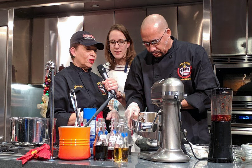 Jennifer Selman (left) demonstrates Caribbean American holiday food traditions with her brother Wayne and presenter Ashley Rose Young at the National Museum of American History on December 2, 2017. Photo by Betty Belanus