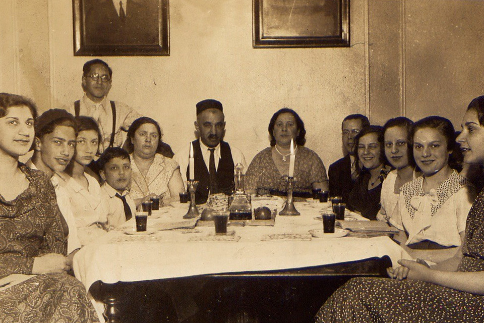 Future Smithsonian Folkways Recordings artist Joe Glazer (second from left) sits with a dozen family members and friends at a 1933 Passover Seder in the Bronx, New York. Photo courtesy of the Glazer and May families