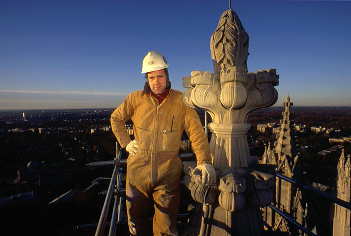 Joe Alonso on top of the Washington National Cathedral's northwest tower. Photo by Matthew Girard