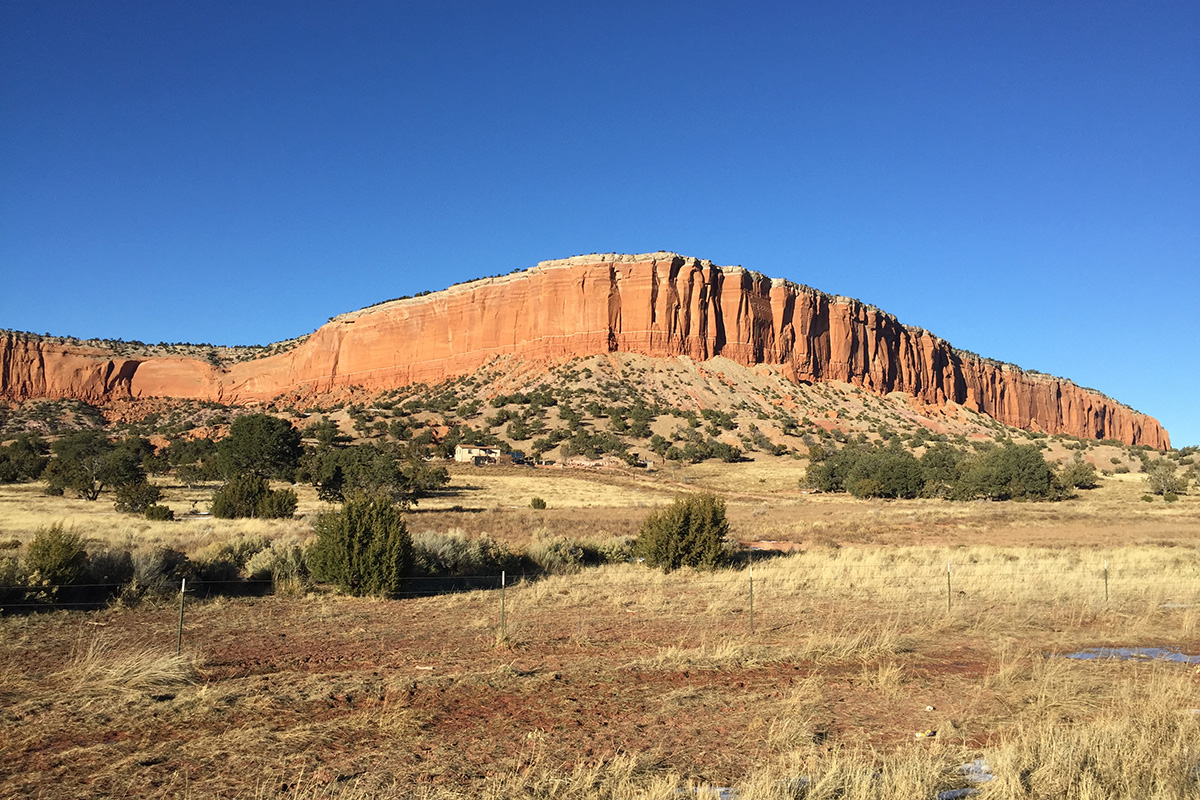 "Located on the Navajo reservation between Thoreau and Crownpoint, New Mexico, this mesa is called Dził Látaa hozhóní, translated as ""the top of the mountain is beautiful."" Photo by Amy Horowitz"