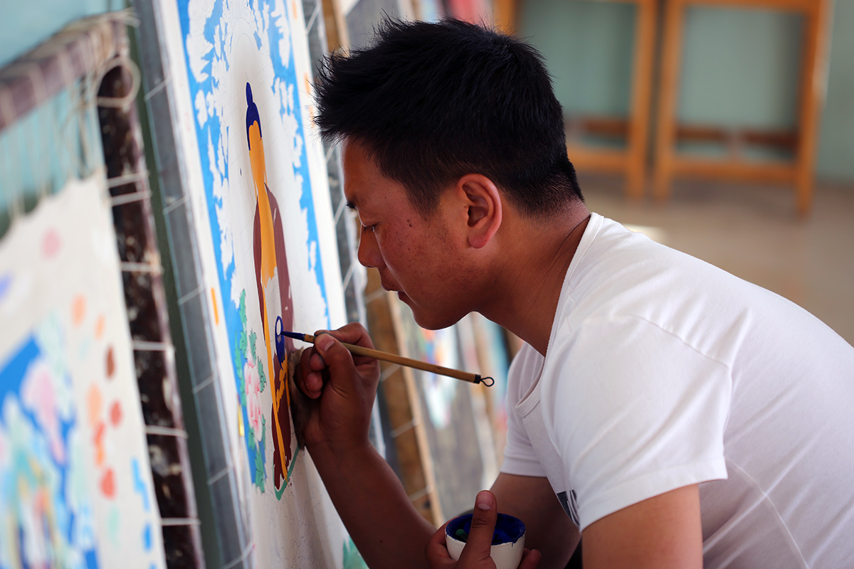 Shawko Drukyal works on a thangka painting. Photo by Dawa Drolma