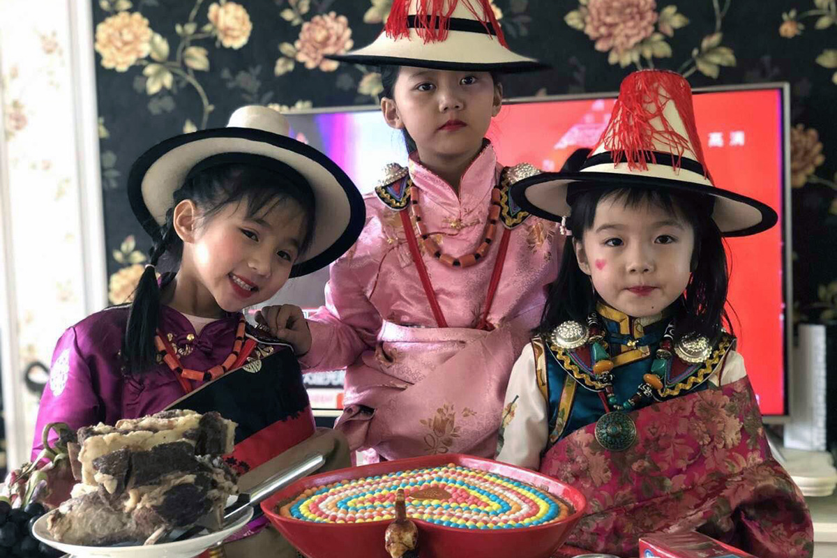 Tibetan children in traditional dress for Losar celebrations. Photo by Jixiancairang