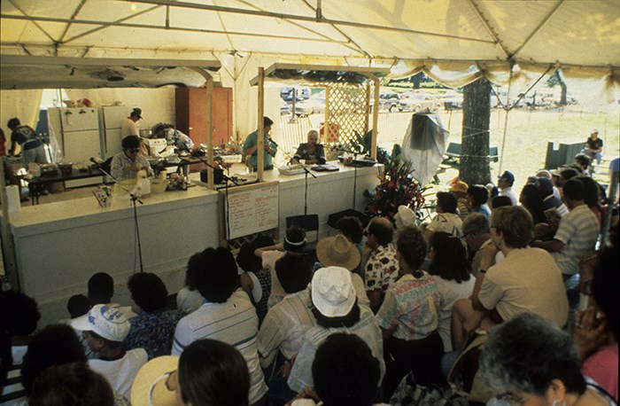 The Hawaiian foodways demonstration kitchen at the 1989 Folklife Festival featured Okinawan, Filipino, Portuguese, Chinese, and native Hawaiian cooking. Ralph Rinzler Folklife Archives