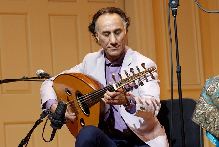 A smile creeps onto Rahim AlHaj's face at the Library of Congress in July 2016. Photo by SarahVictoria Rosemann, Smithsonian