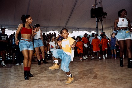 Young visitors try their feet at hip-hop dance at the 1993 Folklife Festival. Photo by Jeff Tinsley, Ralph Rinzler Folklife Archives