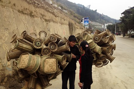 A basket seller carts his wares in Guandong town, a predominantly Dong community in Guizhou Province.