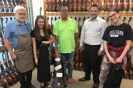 Robertson & Sons Violin Shop generously donated violins to The Heartbeat Project in 2017. Left to right: shop owner Dan Robertson, music teacher Leerone Hakami, Navajo Technical University professor Wesley Thomas, Dan's son Aaron Robertson, and Heartbeat Project director Ariel Horowitz. Photo courtesy of The Heartbeat Project