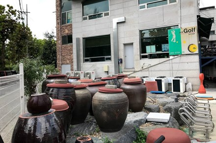 Onggi jars outside a popular cold noodle restaurant in Daejeon, South Korea