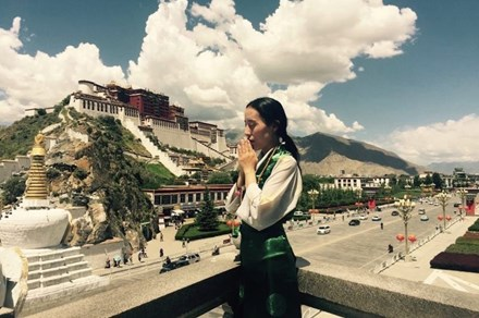 Khamo Kyit n front of Potala Palace in Lhasa
