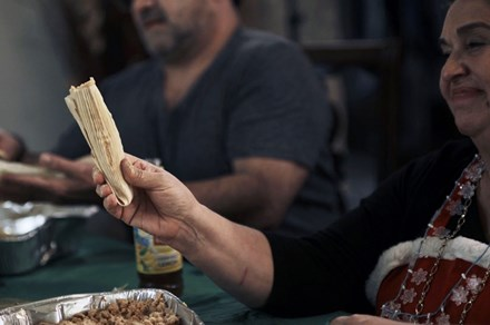 Laura Wilmot fills tamales at the family's annual tamalada. Photo by Charlie Weber