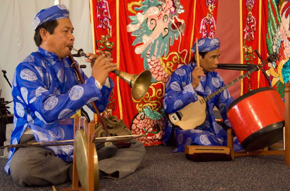 Members of the Hat Boi Folk Opera from Vietnam perform in the Mekong River program at the 2007 Smithsonian Folklife Festival. Photo by Richard Strauss.