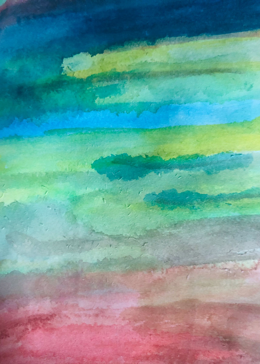 Abstract watercolor painting that looks like a sunset: streaks of red, blue, and green.