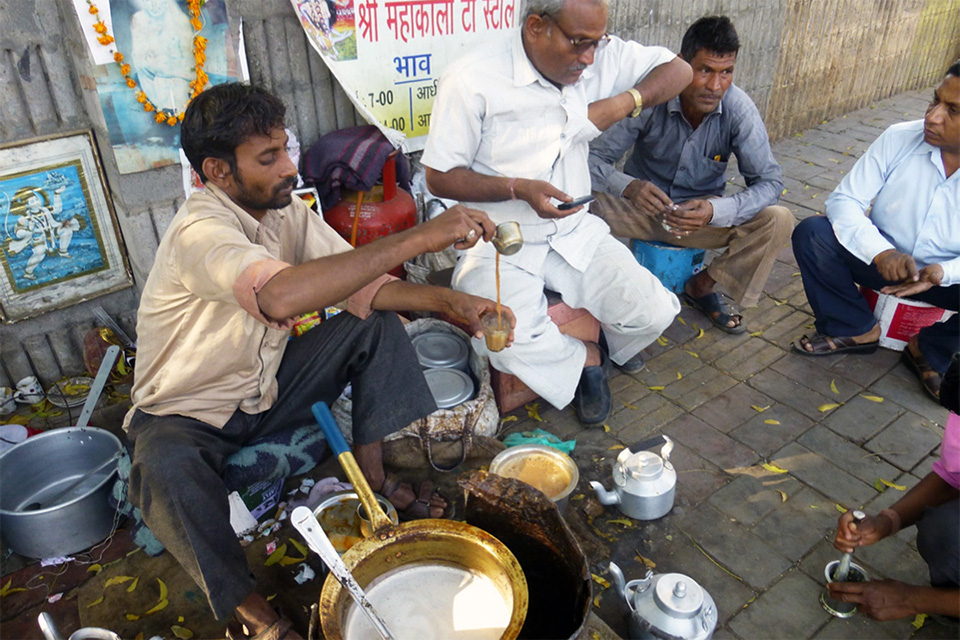 A street vendor serves chai.
