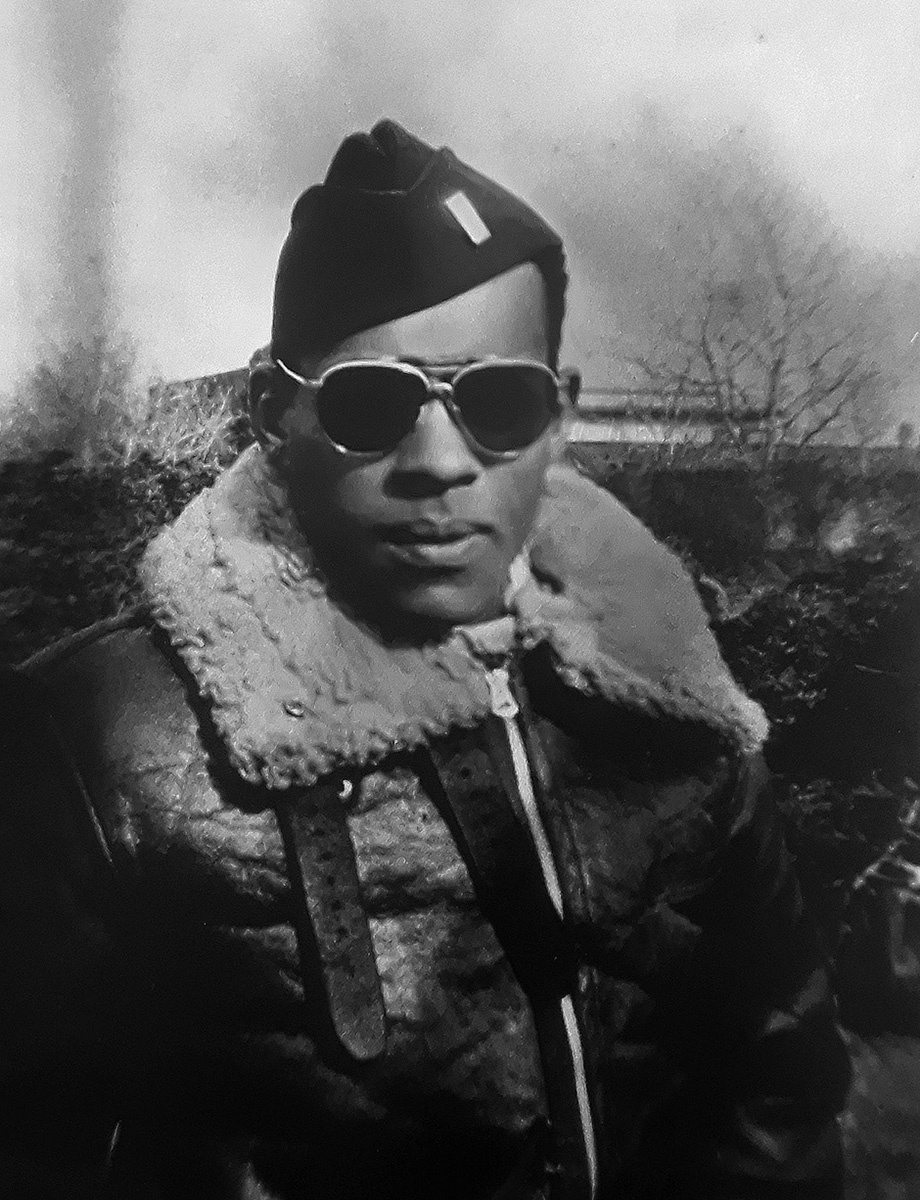 Black-and-white photo of James Wiley in bomber jacket, shades, and military cap