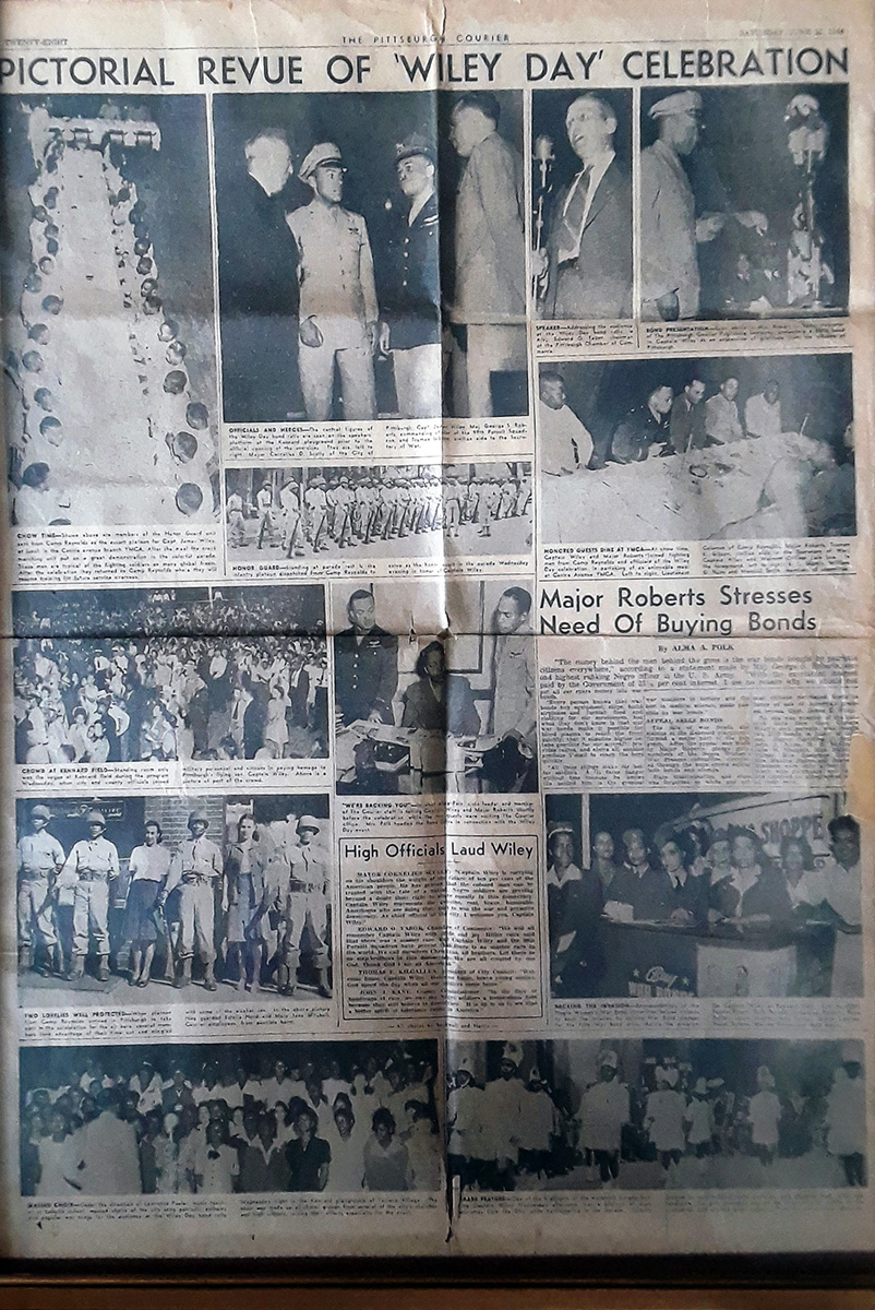 Newspaper clipping headling reads: PICTORIAL REVUE OF 'WILEY DAY' CELEBRATION. Several black-and-white photos of people in uniforms and captions that are too small to read.