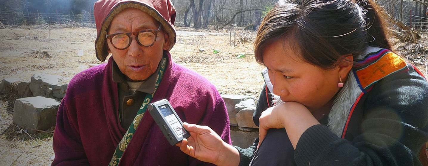 Linguist Yu Lha collects stories from elders in her Khroskyabs speaking community in western China. Photo credit: Yu Lha.