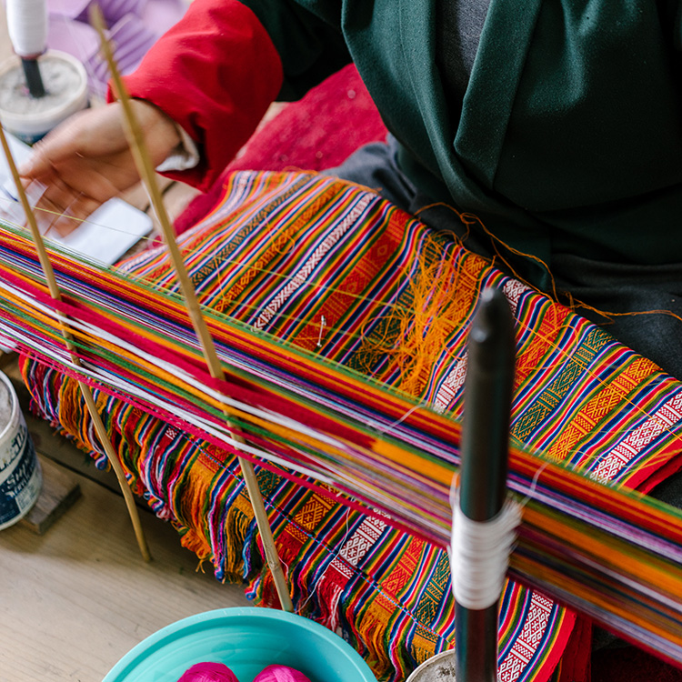 A student weaves at the Choki Traditional Art  School, established in 1999 on the outskirts of Thimphu, Bhutan, for  underprivileged children to learn painting, wood carving, weaving, and embroidery. Photo by Jake Naughton, Smithsonian