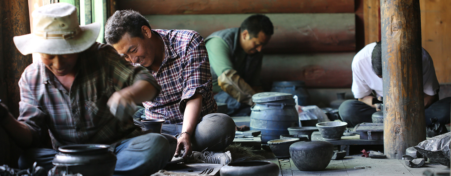 Potters in their workshop in Dzongsar, China,  creating black pottery tea pots, cups, and bowls. Photo by Josh Eli Cogan, Ralph Rinzler Folklife Archives