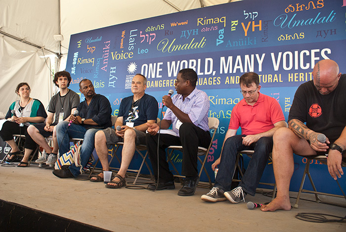 Project manager Meredith Holmgren (far left) leads a discussion about language and cultural policy at the 2013 Smithsonian Folklife Festival.
