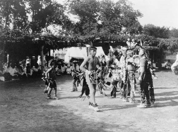 Skidi and Wichita dancers at a powwow, circa 1927.