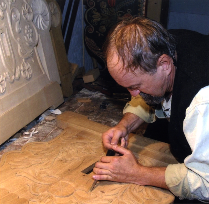 Levente Sütő crafts traditional furniture by carving and painting with traditional methods.
