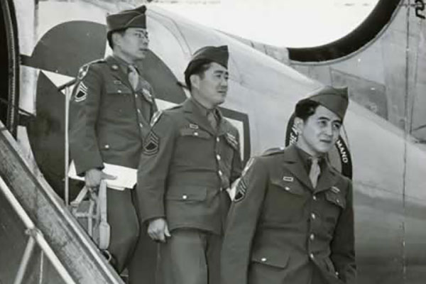 Japanese-American troops return from Burma