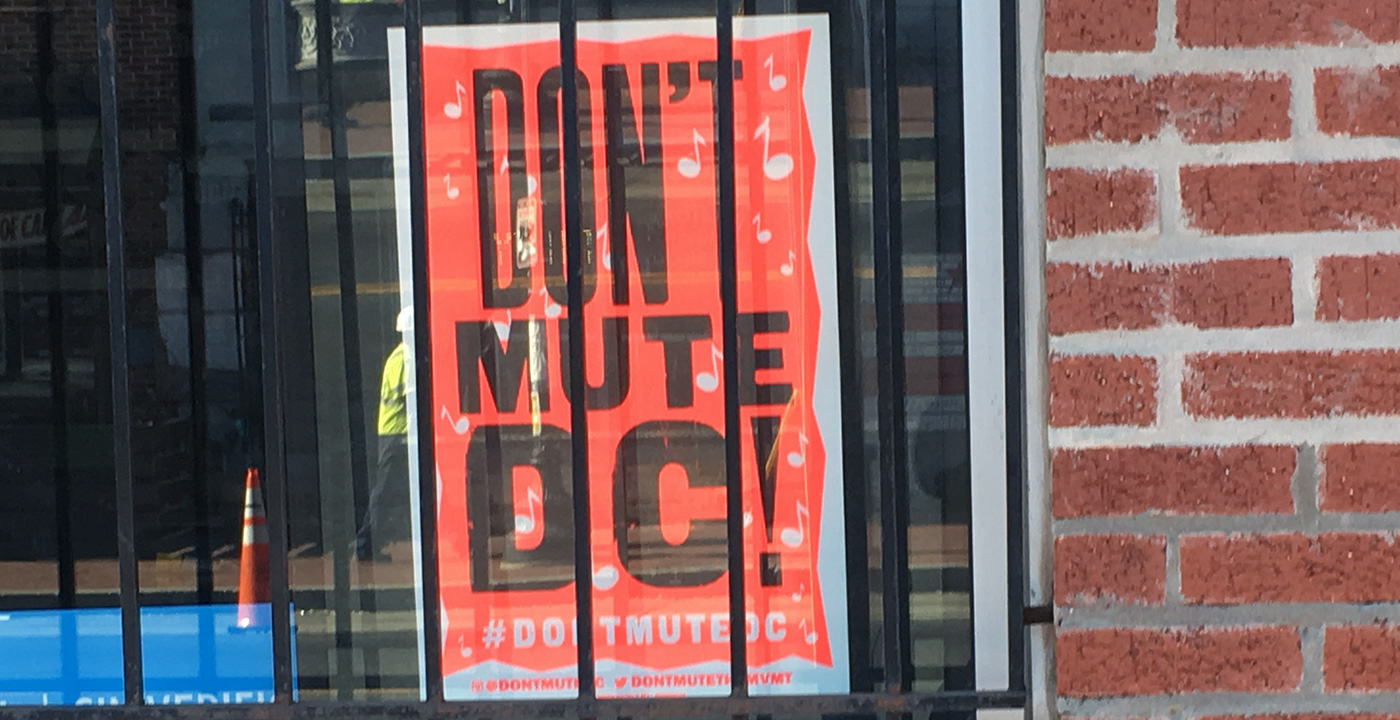Globe Poster in the window of Central Communications (Metro PCS), ground zero of the Don't Mute DC movement.