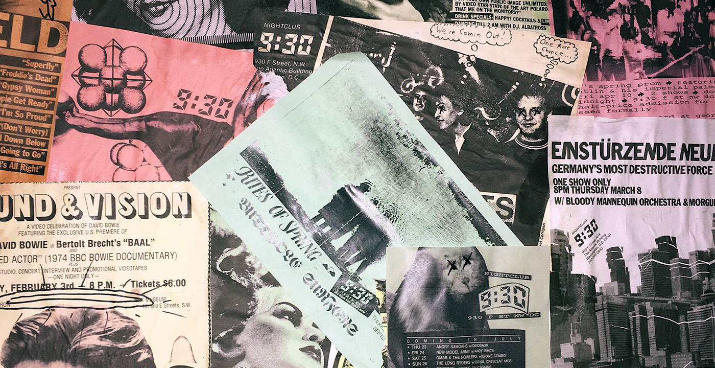 Many layers of black-and-white photocopied flyers on colored paper on a bulletin board