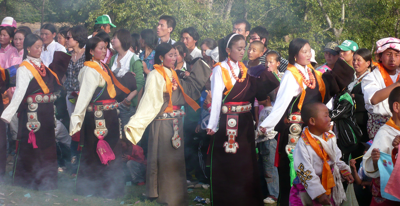 Image of ceremonial dancers participating in the Lurol festival in Tibet.