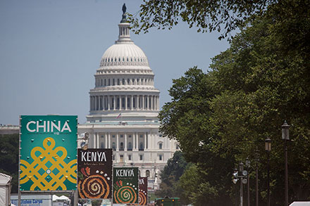 The U.S. Capitol building in the distance, with event banners reading KENYA and CHINA in the foreground.